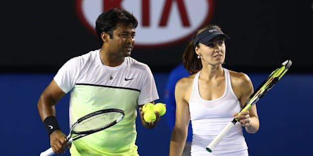 MELBOURNE, AUSTRALIA - FEBRUARY 01:  Martina Hingis of Switzerland and Leander Paes of India celebrate winning their final mixed doubles match against Kristina Mladenovic of France and Daniel Nestor of Canada during day 14 of the 2015 Australian Open at Melbourne Park on February 1, 2015 in Melbourne, Australia.  (Photo by Cameron Spencer/Getty Images)