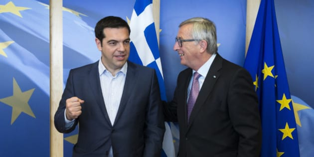 Greek Prime Minister Alexis Tsipras, left, is greeted by European Commission President Jean-Claude Juncker prior to a meeting at EU headquarters in Brussels on Wednesday, June 24, 2015. Eurozone finance ministers meet Wednesday to discuss the Greek bailout. (Julien Warnand/Pool Photo via AP)