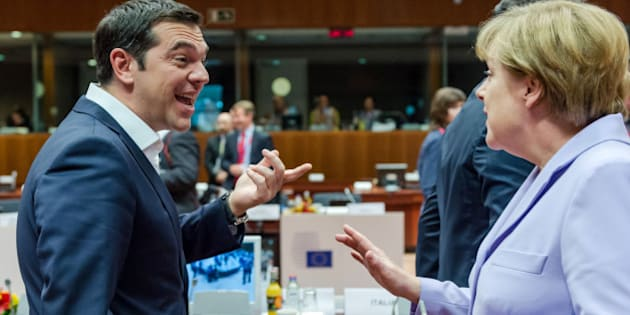 Greek Prime Minister Alexis Tsipras, left, speaks with German Chancellor Angela Merkel during a round table meeting at an EU summit in Brussels on Thursday, June 25, 2015. Greece and its creditors launched a new round of talks in Brussels early Thursday in a fresh bid to unlock billions of euros in loans and save the country from bankruptcy. (AP Photo/Geert Vanden Wijngaert)