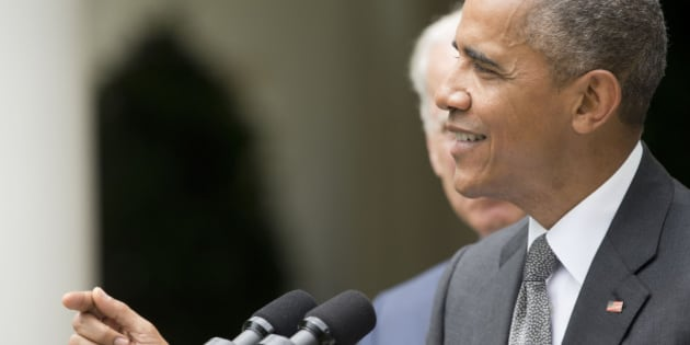 President Barack Obama, accompanied by Vice President Joe Biden, speaks in the Rose Garden of the White House, Thursday, June 25, 2015, after the Supreme Court upheld the subsidies for customers in states that do not operate their own exchanges under President Barack Obama's Affordable Care Act. (AP Photo/Pablo Martinez Monsivais)
