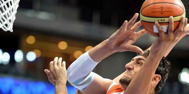 Satnam Singh Bharama (R) of India takes a shot against Kazakhstan during the Asian basketball championship game for men in Manila on August 3, 2013. Kazakhstan won 80-67.    AFP PHOTO/TED ALJIBE        (Photo credit should read TED ALJIBE/AFP/Getty Images)