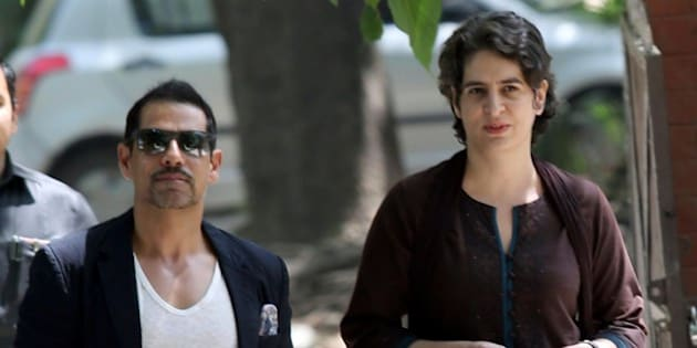 Priyanka Gandhi (R), daughter of India's Congress Party president Sonia Gandhi, and her husband Robert Vadra arrive at a polling station to cast their votes in New Delhi on April 10, 2014.  The third phase of voting in India's national elections began at 7:00 am (0130 GMT) in 91 constituencies, representing nearly a fifth of the 543-seat lower house, across the capital and 13 other states, including Maoist insurgency-hit eastern India. AFP PHOTO/RAVEENDRAN        (Photo credit should read RAVEENDRAN/AFP/Getty Images)