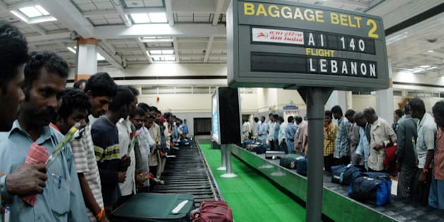 Indians from Lebanon wait for their baggage near a conveyor belt inside Madras international airport in Madras, India, Friday, July 21, 2006. 341 Indians evacuated from troubled Lebanon by ship to the Cypriot city of Larnaca, were airlifted to Madras late Friday night. (AP Photo/M.Lakshman)