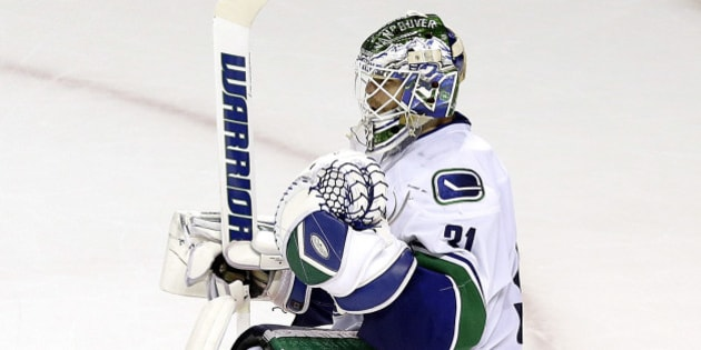Vancouver Canucks goalie Eddie Lack celebrates after the third period of an NHL hockey game against the San Jose Sharks in San Jose, Calif., Saturday, March 7, 2015. The Canucks won 3-2. (AP Photo/Jeff Chiu)