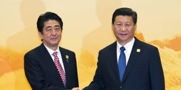 Japan's Prime Minister Shinzo Abe shakes hands with Chinese President Xi Jinping during a welcome ceremony for the Asia-Pacific Economic Cooperation (APEC) Economic Leaders Meeting held at the International Convention Center in Yanqi Lake, Beijing, on Tuesday, Nov 11, 2014. (AP Photo/Ng Han Guan)