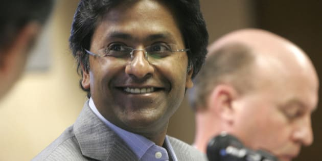 Chairman of the Indian Premier League Lalit Modi smiles at a news conference in Johannesburg, Tuesday, March 24, 2009. Modi announced that the Indian Premier League's Twenty20 cricket tournament will be played in South Africa from April 18.   (AP Photo/Denis Farrell)