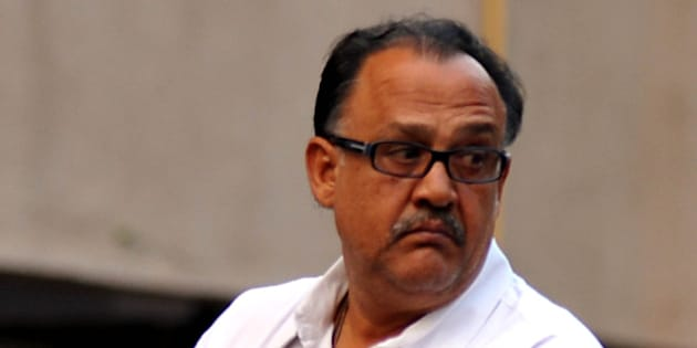 Indian Bollywood actor Alok Nath attends a memorial prayer for late Bollywood actor Farooq Sheikh in Mumbai on December 30, 2013. Sheikh died of a heart attack late December 27 in Dubai where he was on holiday. He was 65. AFP PHOTO/STR        (Photo credit should read STRDEL/AFP/Getty Images)