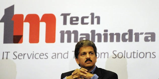 Chairman  of Tech Mahindra, Anand Mahindra listens to a question during a press conference in Hyderabad on April 20, 2009.  India's Tech Mahindra has won the bid for Satyam Computers Sevices in a sale aimed at giving the scandal-hit outsourcing giant vital fresh capital and a new begining.  AFP PHOTO / Noah SEELAM (Photo credit should read NOAH SEELAM/AFP/Getty Images)