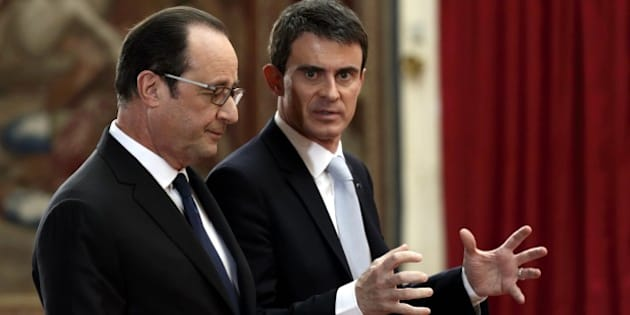 French President Francois Hollande, left, and French Prime Minister Manuel Valls leave after Hollande's press conference at the Elysee Palace in Paris, Thursday, Feb. 5, 2015. The leaders of France and Germany were carrying a new peace initiative to the Ukrainian and Russian capitals Thursday, amid a flurry of high-level diplomacy to end what French President Francois Hollande called a war on Europe's edge. (AP Photo/Philippe Wojazer, Pool)