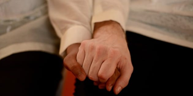 US Michael Ellis (R) and Filipino Jesus Bascal (L) hold hands during a 'Rite of Holy Union' ceremony for the Lesbians Gays Bisexual and Transgenders (LGBT) community in Manila on June 28, 2015. The leadership of the Philippines' dominant Roman Catholic church stressed its opposition to legalising gay marriage today despite last week's landmark decision by the US Supreme Court.  AFP PHOTO / NOEL CELIS        (Photo credit should read NOEL CELIS/AFP/Getty Images)