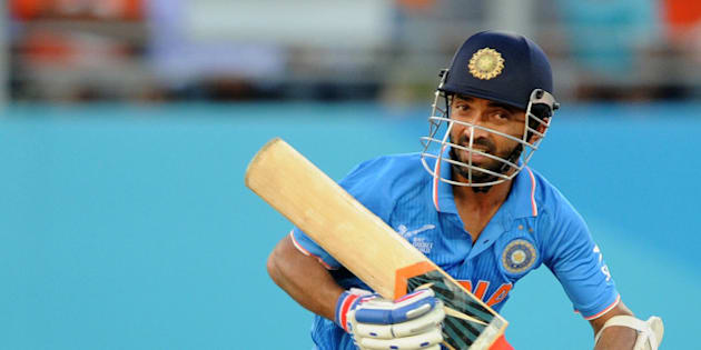 India's Ajinkya Rahane runs down the wicket while batting against Zimbabwe during their Cricket World Cup Pool B match in Auckland, New Zealand, Saturday, March 14, 2015. (AP Photo/Ross Setford)