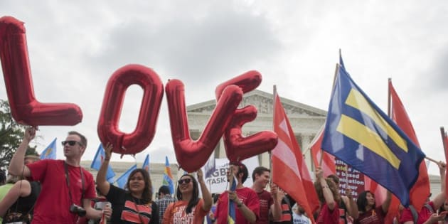 IMAGE DISTRIBUTED FOR HUMAN RIGHTS CAMPAIGN - Marriage equality supporters rally on the steps of the Supreme Court as they wait for a decision Friday, June 26, 2015, in Washington.  (Kevin Wolf/AP Images for Human Rights Campaign)