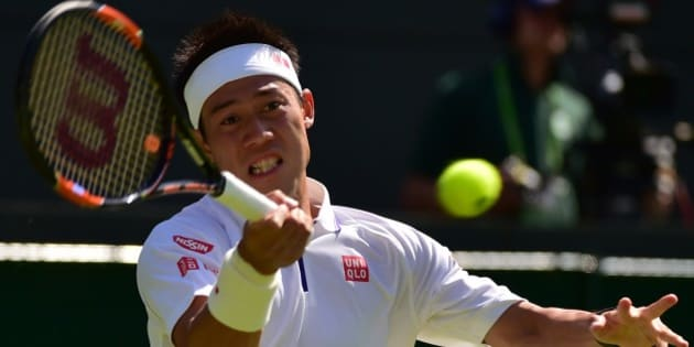 Japan's Kei Nishikori returns against Italy's Simone Bolelli during their men's singles first round match on day one of the 2015 Wimbledon Championships at The All England Tennis Club in Wimbledon, southwest London, on June 29, 2015.   RESTRICTED TO EDITORIAL USE  -- AFP PHOTO / LEON NEAL        (Photo credit should read LEON NEAL/AFP/Getty Images)