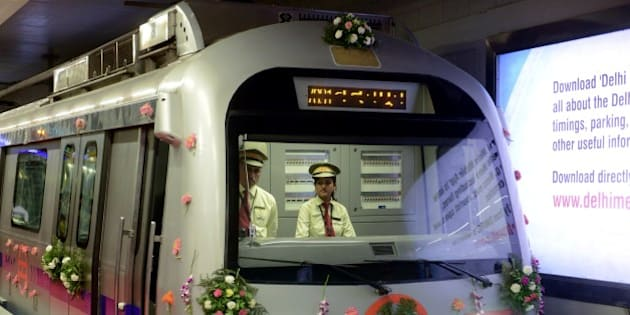 A decorated Delhi Metro train is pictured at the Mandi House station platform during a flagging-off ceremony in New Delhi on June 26, 2014.  The Delhi Metro opened the Mandi House - Central Secretariat route to the public on June 26. Over two million commuters use the Delhi Metro in the Indian capital daily. AFP PHOTO/RAVEENDRAN        (Photo credit should read RAVEENDRAN/AFP/Getty Images)