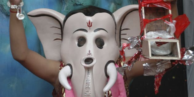 A man dressed as the Hindu elephant headed god Ganesha enacts defusing a bomb during Ganesh festival in Ahmadabad, India, Wednesday, Sept.3, 2008. Serial bombings in the city last month had killed 58 people. (AP Photo/Ajit Solanki)