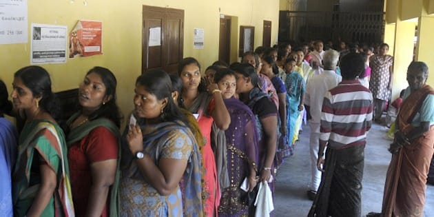 Indian voters queue at a polling station in Trivandrum in southern Kerala state on April 10, 2014.  Voters went to the polls on the first major day of India's marathon national election, with the capital New Delhi a key battleground for an anti-corruption party which shot to fame last year.   AFP PHOTO        (Photo credit should read STR/AFP/Getty Images)