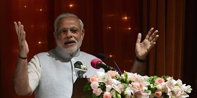 Indian Prime Minister Narendra Modi delivers a speech at presidential residence Bangabhaban in the Bangladesh capital Dhaka on June 7, 2015. Bangladesh and India on June 6, 2015 sealed a historic land pact to swap territories, which will finally allow tens of thousands of people living in border enclaves to choose their nationality after decades of stateless limbo. AFP PHOTO/ Munir uz ZAMAN        (Photo credit should read MUNIR UZ ZAMAN/AFP/Getty Images)