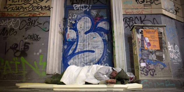 ATHENS, GREECE - JANUARY 21:  A homeless man sleeps in a doorway on the streets of Athens ahead of this weekend general election on January 21, 2015 in Athens, Greece. According to the latest opinion polls, the left-wing Syriza party are poised to defeat Prime Minister Antonis Samaras' conservative New Democracy party in the election, which will take place on Sunday. European leaders fear that Greece could abandon the Euro, write off some of its national debt and put an end to the country's austerity by renogotiating the terms of its bailout if the radical Syriza party comes to power. Greece's potential withdrawal from the eurozone has become known as the 'Grexit'. (Photo by Matt Cardy/Getty Images)