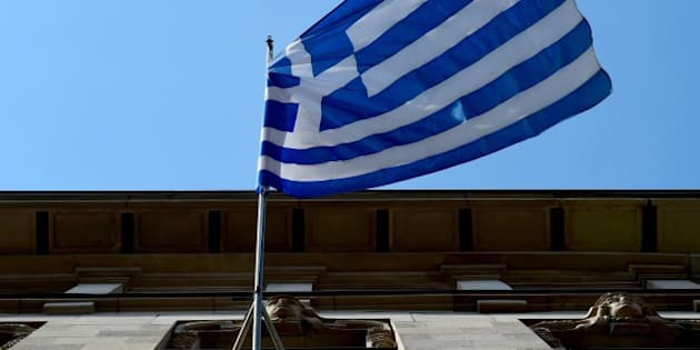 The Greek national flag is on display outside the Embassy of Greece to Germany on June 29, 2015 in Berlin. After talks between Athens and its creditors broke down, leaving Greece headed for an EU-IMF default and possible exit from the eurozone, the ECB said on June 28, 2015 it would keep open Emergency Liquidity Assistance (ELA) to the debt-hit country's banks. 