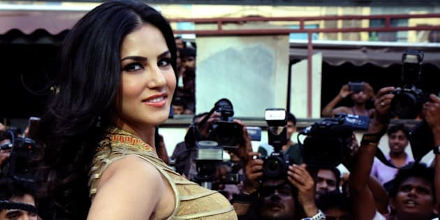Indian actress and former adult film actress Sunny Leone poses for a photograph during a promotional event for the Hindi film Ragini MMS 2 in Mumbai on late March 26, 2014.  AFP PHOTO / STR        (Photo credit should read STRDEL/AFP/Getty Images)