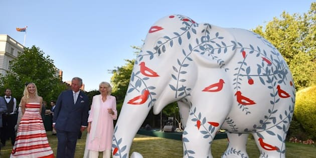 Britain's Prince Charles (C), Prince of Wales and Britain's Camilla, Duchess of Cornwall host a reception in support of the Elephant family, a charity set up by Mark Shand, the Duchess of Cornwall's brother in London on June 30. 2015. The event called Travels to my Elephant will see painted rickshaws auctioned to raise money for Asian Elephants and later this year taking part in a race across Madhya Pradesh in India. AFP PHOTO / BEN STANSALL        (Photo credit should read BEN STANSALL/AFP/Getty Images)