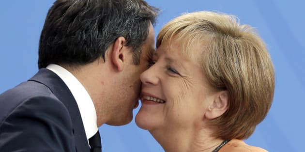 German Chancellor Angela Merkel, right,  hugs  the Prime Minster of Italy, Matteo Renzi, left, after a joint press conference as part of a meeting at the chancellery in Berlin, Germany, Wednesday, July 1, 2015. (AP Photo/Michael Sohn)
