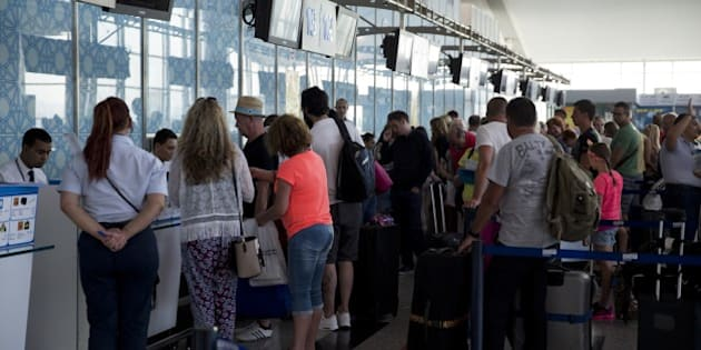 British tourists queue up at the check-in counter at the Enfidha International airport on June 28, 2015, as they leave Tunisia two days after a shooting attack on the Riu Imperial Marhaba Hotel in Port el Kantaoui, on the outskirts of Sousse south of the capital Tunis. The attack saw a Tunisian student disguised as a tourist pull out a Kalashnikov assault rifle hidden inside a beach umbrella and open fire on holidaymakers at a popular beach resort killing 38 people, most of them British tourists, in the worst attack in the country's recent history. AFP PHOTO / KENZO TRIBOUILLARD        (Photo credit should read KENZO TRIBOUILLARD/AFP/Getty Images)