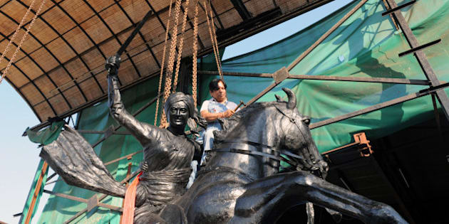 Indian craftswoman Jasuben Shilpi, known as the  Bronze Woman of India, gives finishing touches to a life-size bronze statue of 'Jhansi-Ki-Rani or Queen Of Jhansi' - Rani Laxmi Bai - at her workshop near Adalaj, some 25 kms from Ahmedabad, on February 3, 2011. The 3.5 ton statue will be installed at Jamnagar this February 5. AFP PHOTO / Sam PANTHAKY (Photo credit should read SAM PANTHAKY/AFP/Getty Images)