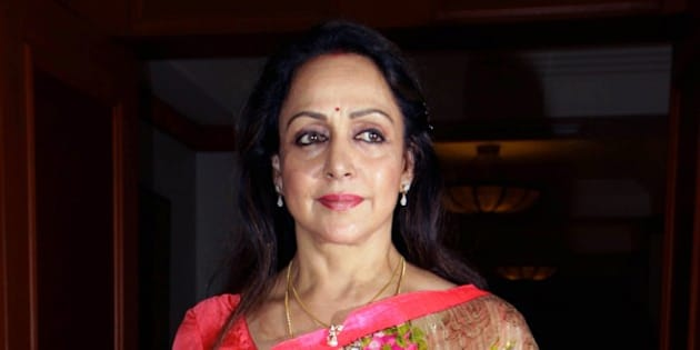 Indian Bollywood actress Hema Malini poses as she attend a press conference to announce the second national ' Yash Chopra Memorial Awards in Mumbai on November 20, 2014. AFP PHOTO/STR        (Photo credit should read STRDEL/AFP/Getty Images)