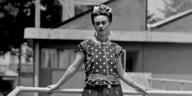 FILE - In this April 14, 1939 file photo, painter Frida Kahlo poses at her home in Mexico City. The Frida Kahlo Museum in Mexico City presented a multimedia guide that will provide visitors with a greater amount of information about the iconic Mexican painter, as they view her work, Wednesday, April 9, 2014.  (AP Photo/File)