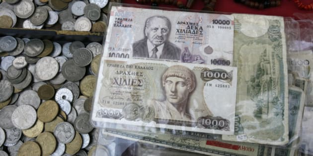 Old Greek drachma coins and notes sit  arranged for sale during an antique bazaar at the northern port city of Thessaloniki Greece on Sunday, Oct. 21 2012. (AP Photo/Nikolas Giakoumidis)