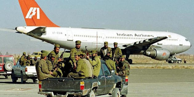 KANDAHAR, AFGHANISTAN:  (FILES) In this picture taken 30 December 1999, Taliban Islamic militia commandos ride in the rear of a truck towards an aircraft of Indian Airlines hijacked by Islamic Kahsmiri militants which stands on the tarmac at Kandahar airport.  An document reported to be from al-Qaeda released 05 February, has hailed the 1999 hijacking of the  Indian Airlines aicraft as a 'successful operation' from which other guerrillas can learn lessons. The plane was hijacked after it left the Nepalese capital, Kathmandu, en route to New Delhi on 24 December 1999, and later landed in the Afghan city of Kandahar.   AFP PHOTO/ Saeed KHAN  (Photo credit should read SAEED KHAN/AFP/Getty Images)