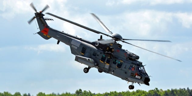 An Airbus Caracal multipurpose helicopter flies over the Powidz airbase in central Poland on May 14, 2015. Poland is testing the helicopters as it seeks to replace its Soviet-era equipment with 50 choppers for an alleged 3,3 billion euros ($3,5 billion). The NATO member is undertaking an uprecedented military upgrade amid heightened tension with neighbouring Russia over the Ukraine crisis.  AFP PHOTO / JANEK SKARZYNSKI        (Photo credit should read JANEK SKARZYNSKI/AFP/Getty Images)