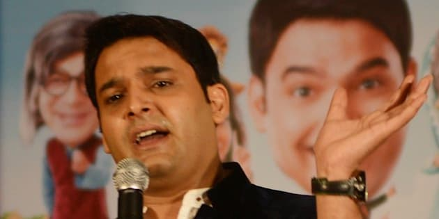 Indian actor  Kapil Sharma speaks during a press conference at a hotel in Amritsar on June 8, 2013. The entertainers visited the Punjabi city to promote a new TV series Comedy Nights with Kapil which will be telecasting  on  Colour TV Channel on June 22. AFP PHOTO/ NARINDER NANU        (Photo credit should read NARINDER NANU/AFP/Getty Images)