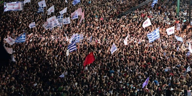 Thousands on 'NO' protesters gather in front of the parliament building in Athens on July 3, 2015. Greek Prime Minister Alexis Tsipras was cheered wildly as he arrived Friday for the rally in Athens' Syntagma Square, two days before a crucial bailout referendum. AFP PHOTO/ Louisa Gouliamaki        (Photo credit should read LOUISA GOULIAMAKI/AFP/Getty Images)