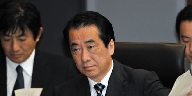 (FILES) This file picture taken on May 28, 2012 shows former Japanese prime minister Naoto Kan (C) speaking at a parliamentary commission in Tokyo probing the Fukushima nuclear disaster. A parliamentary probe into the nuclear disaster at Fukushima will publish its final report on July 5, 2012, and is expected to say Japan's last prime minister fanned chaos in the opening days of the crisis.        AFP PHOTO / FILES / Yoshikazu TSUNO        (Photo credit should read YOSHIKAZU TSUNO/AFP/GettyImages)