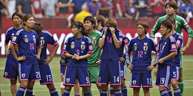Members of the Japan team react to losing the championship match against the USA at BC Place Stadium during the 2015 FIFA Women's World Cup in Vancouver on July 5, 2015.   AFP PHOTO/ANDY CLARK        (Photo credit should read ANDY CLARK/AFP/Getty Images)