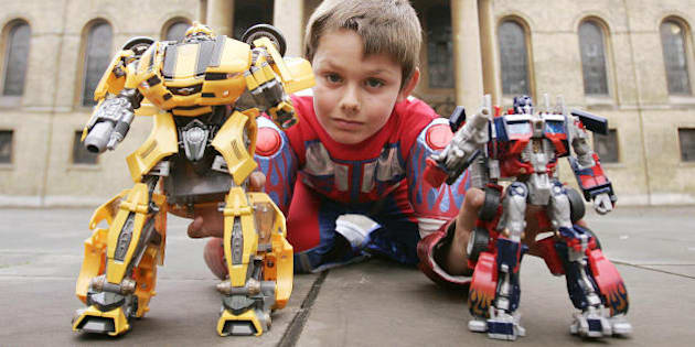 A boy plays with 'Transformer robots,' at a photocall in central London, 10 October 2007, as the Toy Retailers Association unveils this year's official Top Toy predictions for Christmas. AFP PHOTO/SHAUN CURRY (Photo credit should read SHAUN CURRY/AFP/Getty Images)