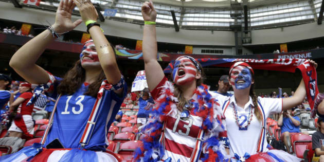 United States fans cheer before the FIFA Women's World Cup soccer championship between the U.S. and Japan in Vancouver, British Columbia, Canada, Sunday, July 5, 2015. (AP Photo/Elaine Thompson)