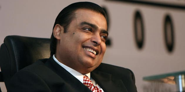 Chairman and Managing Director of India's Reliance Industries Ltd, Mukhesh Ambani smiles as he attends a session at The India Today Conclave - 'Leadership for the 21st Century' in New Delhi on March 14, 2008.  During the inaugural keynote address for the conclave via satellite on March 13, former US President Bill Clinton indicated that any future administration would 'honour' the Indo-US nuclear deal after forthcoming US presidential elections amid speculation about the fate of the agreement which is yet to be ratified. Key US senators and top officials have stepped up pressure on New Delhi to speed up steps so the pact can get final approval from the US Congress, where it has bipartisan support, before the US presidential polls in November 2008.   AFP PHOTO/RAVEENDRAN (Photo credit should read RAVEENDRAN/AFP/Getty Images)