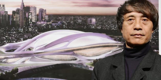 Japanese architect Tadao Ando, who is also chairman of the jury for an international design competition of the new national stadium, introduces a design by British architect Zaha Hadid during a press conference in Tokyo on November 15, 2012. The construction of the new stadium is scheduled to be completed in 2019, one year before the 2020 Olympic games which Tokyo aims at host city.   AFP PHOTO/Toru YAMANAKA        (Photo credit should read TORU YAMANAKA/AFP/Getty Images)