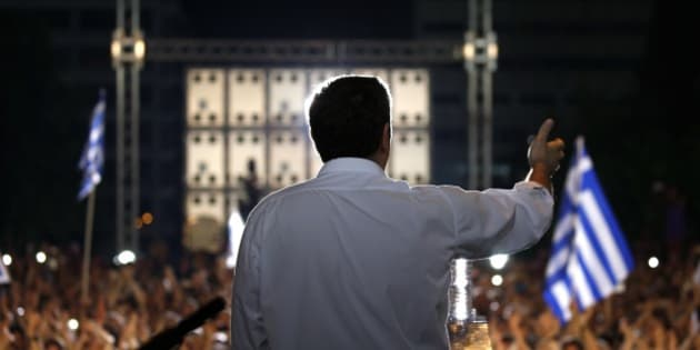 Greece's Prime Minister Alexis Tsipras delivers a speech during a rally organized by supporters of the No vote at Syntagma square in Athens, Friday, July 3, 2015. A new opinion poll shows a dead heat in Greece's referendum campaign with just two days to go before Sunday's vote on whether Greeks should accept more austerity in return for bailout loans. (Yannis Behrakis/Pool via AP)