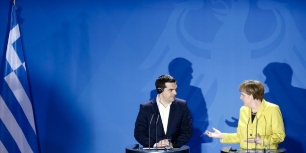 FILE - In this March 23, 2015 file photo German Chancellor Angela Merkel, right, and the Prime Minister of Greece Alexis Tsipras brief the media during a bilateral meeting at the chancellery in Berlin. The impasse in negotiations to unblock international financial aid to cash-strapped Greece wasn't officially on the agenda of the G-7 summit in Elmau, but still overshadowed discussions of the global economy. (AP Photo/Markus Schreiber, file)
