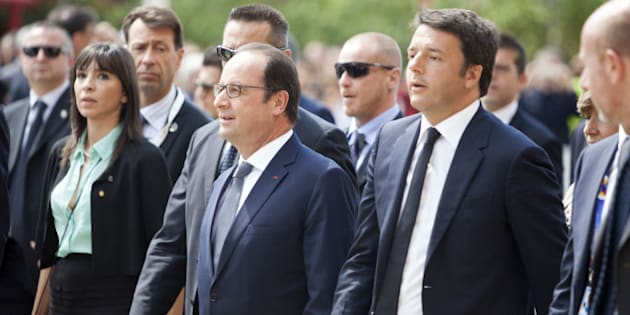 French President Francois Hollande, center, and Italian Prime Minister Matteo Renzi, right, arrive at the 2015 Expo in Rho, near Milan, Italy, Sunday, June 21, 2015. (AP Photo/Carlo Cerchioli)