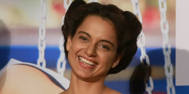 "Indian Bollywood actress Kangana Ranaut smiles as she listens to a question from a journalist during the trailer launch of her forthcoming movie ""Katti Batti"" in Mumbai, India, Sunday, June 14, 2015. The romantic comedy movie is scheduled to be released on Sept. 18, 2015. (AP Photo/Rafiq Maqbool)"
