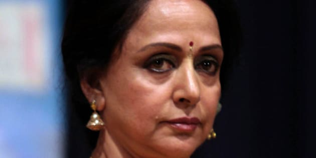 Indian Bollywood actress Hema Malini poses during the launch of her first album Soundaryalahari in Mumbai late October 30, 2013.   AFP PHOTO/STR        (Photo credit should read STRDEL/AFP/Getty Images)