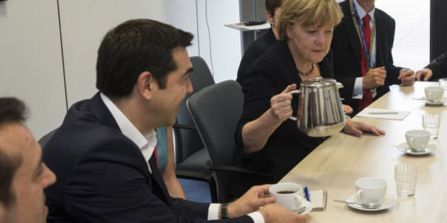 Greek Prime Minister Alexis Tsipras, left, and German Chancellor Angela Merkel are pictured during a meeting with European Commission President Jean-Claude Juncker and French President Francois Hollande prior to a euro zone leaders summit in Brussels, Belgium, Tuesday, July 7, 2015. Greece faces a last chance to stay in the euro zone on Tuesday when Prime Minister Alexis Tsipras puts proposals to an emergency euro zone summit after Greek voters resoundingly rejected the austerity terms of a defunct bailout. (Philippe Wojazer/Pool Photo via AP)