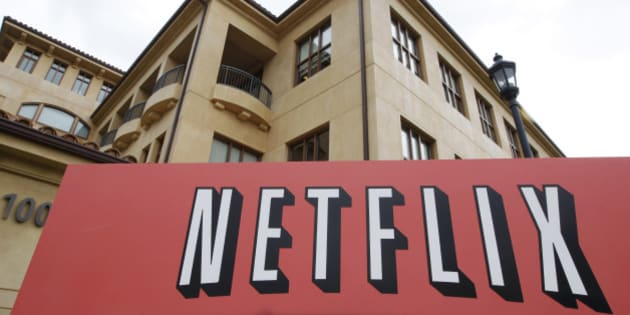 The exterior of Netflix headquarters is seen in Los Gatos, Calif., Monday, Oct. 10, 2011. On Monday, Netflix said it would reverse a previously announced decision to put its DVD-by-mail and Internet streaming services on separate websites, a plan that was widely derided by Netflix subscribers. Subscribers will be able to use both services under one account and one password, CEO Reed Hastings said Monday in a blog post.. (AP Photo/Paul Sakuma)