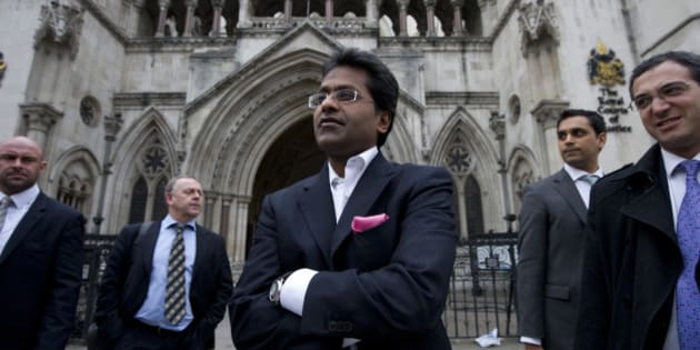 Ex-chairman of India's cricket IPL, Lalit Modi (C), leaves the High Court in central London on March 5, 2012, after a hearing in a libel case brought against him by Former New Zealand cricket captain Chris Cairns. Cairns told the High Court in London on Monday that an accusation of match-fixing had reduced his career to 'dust' and strained his marriage.   Cairns, 41, is suing Lalit Modi, the former chairman of Twenty20 franchise the Indian Premier League (IPL), for substantial libel damages over an 'unequivocal allegation' made on Twitter. AFP PHOTO / CARL COURT (Photo credit should read CARL COURT/AFP/Getty Images)