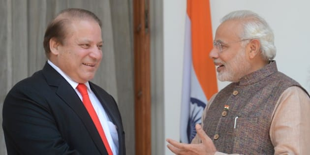India's newly sworn-in Prime Minister Narendra Modi (R) talks with Pakistani Prime Minister Nawaz Sharif as they shake hands during a meeting in New Delhi on May 27, 2014. Indian Prime Minister Narendra Modi met his Pakistani counterpart Nawaz Sharif for landmark talks in New Delhi May 27 in a bid to ease tensions between the nuclear-armed neighbours. AFP PHOTO/RAVEENDRAN        (Photo credit should read RAVEENDRAN/AFP/Getty Images)
